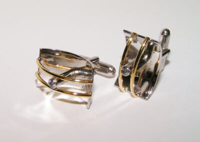 Silver and 9ct yellow gold diamond set cufflinks