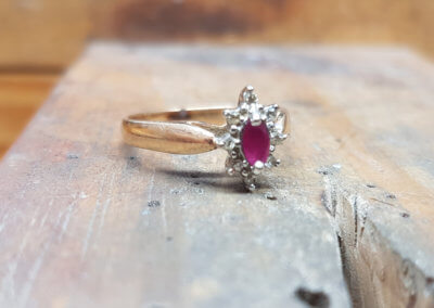 1. original ring. 18ct yellow and white gold set with diamonds and ruby