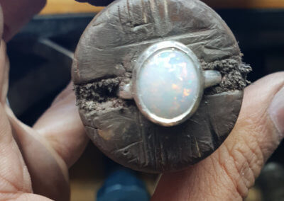 9. setting opal in to the ring.